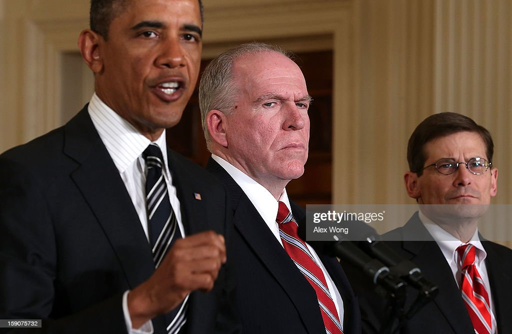 U.S. President Barack Obama (L) speaks as Acting CIA Director Michael Morell (R) and Deputy National Security Advisor for Homeland Security and Counterterrorism John Brennan (2nd L) listen while making personnel announcements during an event in the East Room at the White House, on January 7, 2013 in Washington, DC. President Obama has nominated Hagel for the next Secretary of Defense and Brennan to become the new director of the CIA.
