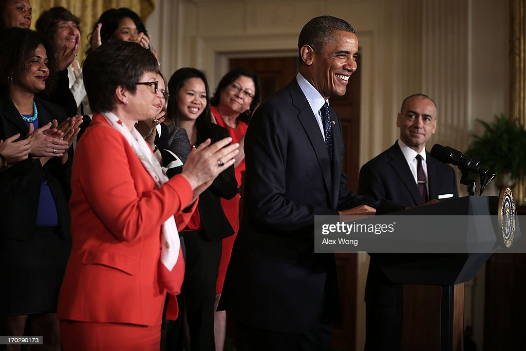 U.S. President <a gi-track='captionPersonalityLinkClicked' href=/galleries/search?phrase=Barack+Obama&family=editorial&specificpeople=203260 ng-click='$event.stopPropagation()'>Barack Obama</a> (2nd R) speaks as CEO of Deloitte Joe Echevarria (R), senior adviser to the President <a gi-track='captionPersonalityLinkClicked' href=/galleries/search?phrase=Valerie+Jarrett&family=editorial&specificpeople=5003206 ng-click='$event.stopPropagation()'>Valerie Jarrett</a> (L) and equal pay supporters look on during an East Room event June 10, 2013 at the White House in Washington, DC. President Obama held an event to mark the 5oth anniversary of the Equal Pay Act.