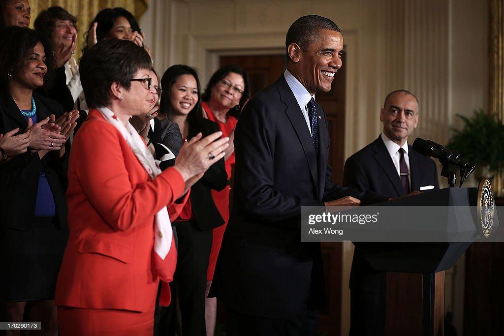 S President Barack Obama speaks as CEO of Deloitte Joe Echevarria senior adviser to the President Valerie Jarrett and equal pay supporters look on...