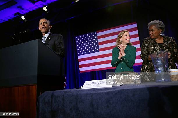 US President Barack Obama speaks as Democratic National Committee Chair and Rep Debbie Wasserman Schultz and Vice Chair for Voter Registration and...