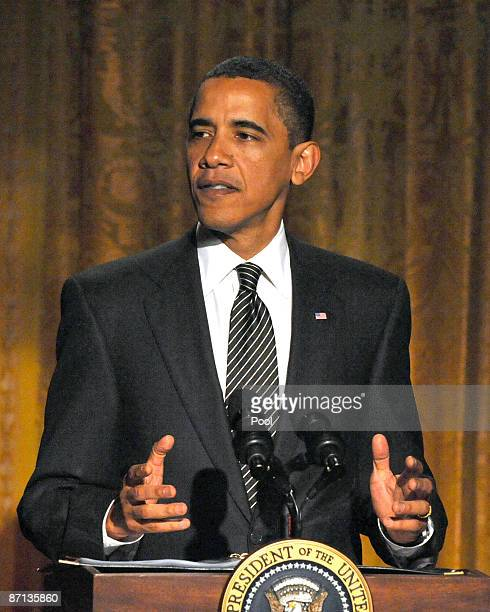 S President Barack Obama speaks as he and first lady Michelle Obama host An Evening of Poetry Music and the Spoken Word in the East Room of the White...