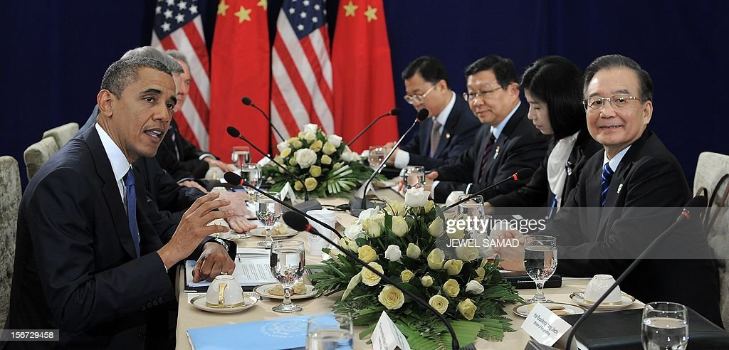 US President Barack Obama (L) speaks as he holds a bilateral meeting with Chinese Premier Wen Jiabao (R) on the sidelines of the East Asian Summit at the Peace Palace in Phnom Penh on November 20, 2012. During the two-day East Asia Summit in Phnom Penh, Obama was scheduled to hold talks with the leaders of the 10-member Association of Southeast Asian Nations (ASEAN) along with Chinese Premier Wen Jiabao and Japan's Yoshihiko Noda. AFP PHOTO / Jewel Samad