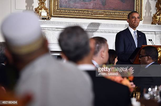 US President Barack Obama speaks as he hosts an Iftar dinner in the State Dinning Room at the White House in Washington on July 14 2014 Obama said he...