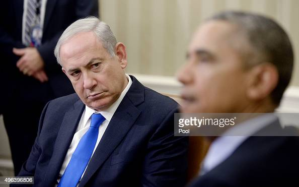 US President Barack Obama speaks as he meets with Israeli Prime Minister Benjamin Netanyahu in the Oval Office of the White House November 9 2015 in...