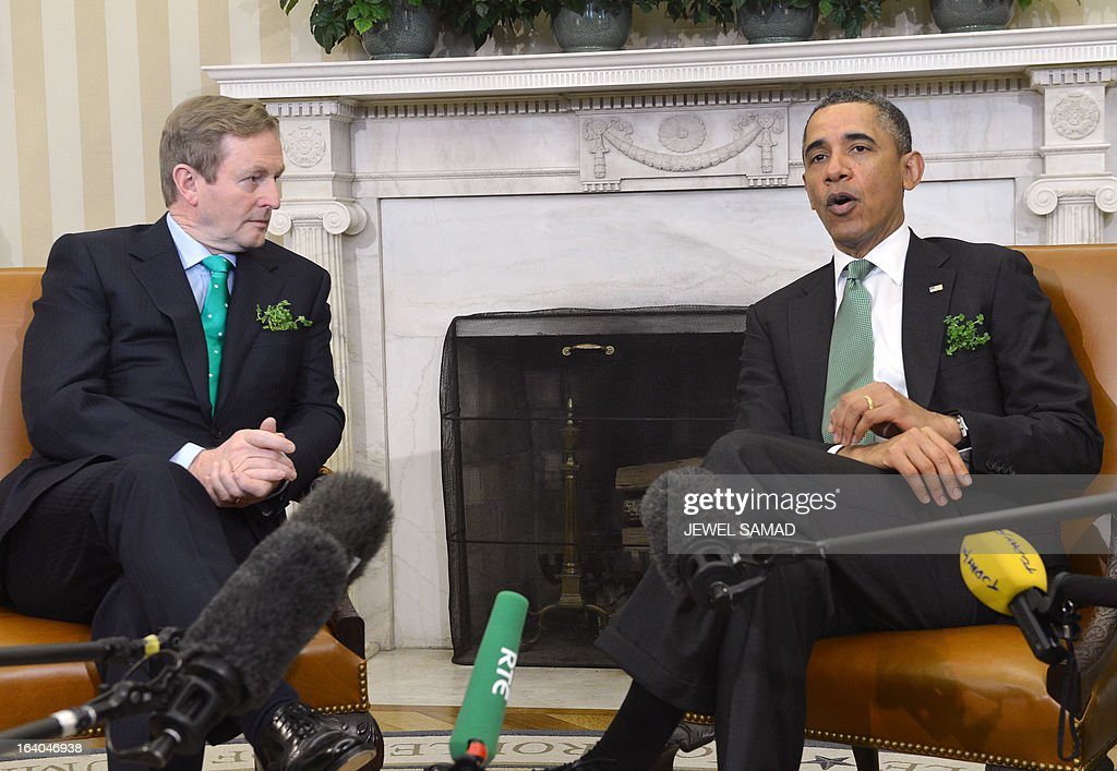 US President Barack Obama speaks as Irish Prime Minister Enda Kenny looks on during a meeting in the Oval Office at the White House in Washington, DC, on March 19, 2013. The two leaders will be attending a luncheon on Capitol Hill later Tuesday. AFP PHOTO/Jewel Samad