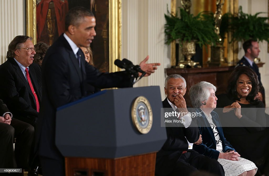 U.S. President Barack Obama speaks as Oprah Winfrey (R), appellate judge Patricia Wald (2nd R), civil rights leader Cordy Tindell 'C.T.' Vivian (3rd R) and jazz musician Arturo Sandoval (L) listen during the Presidential Medal of Freedom presentation ceremony in the East Room at the White House on November 20, 2013 in Washington, DC. The Presidential Medal of Freedom is the nation's highest civilian honor, presented to individuals who have made meritorious contributions to the security or national interests of the United States, to world peace, or to cultural or other significant public or private endeavors.