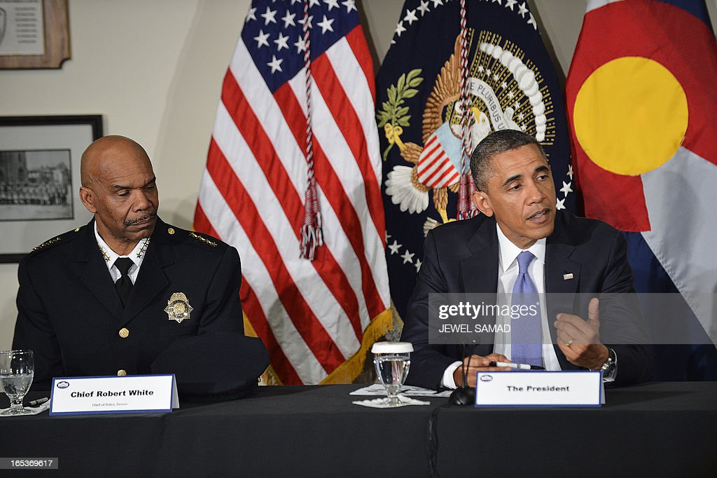 US President Barack Obama speaks as police chief Roger White listens during a meeting with local law enforcement officials and community leaders in Denver, Colorado, on April 3, 2013 as he continues asking the American people to join him in calling on Congress to pass common-sense measures to reduce gun violence. The president has demanded votes on measures including a requirement for background checks on all gun purchases, limits on high capacity ammunition magazines, a reinstated assault weapons ban, new gun trafficking laws, and new school safety plans. But the assault weapons ban push appears certain to fail to get sufficient support in the Senate, following a huge campaign by the gun lobby and opposition from Republicans and Democrats from conservative and rural areas. AFP PHOTO/Jewel Samad