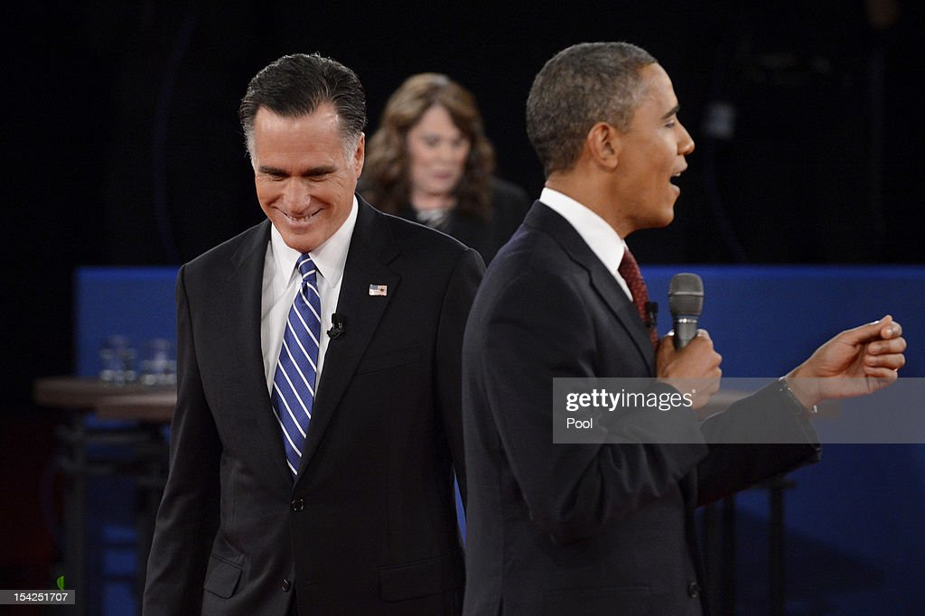 U.S. President Barack Obama (R) speaks as Republican presidential candidate Mitt Romney (L) and moderator Candy Crowley (C) listen during a town hall style debate at Hofstra University October 16, 2012 in Hempstead, New York. During the second of three presidential debates, the candidates fielded questions from audience members on a wide variety of issues.