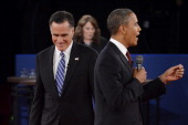S President Barack Obama speaks as Republican presidential candidate Mitt Romney and moderator Candy Crowley listen during a town hall style debate...