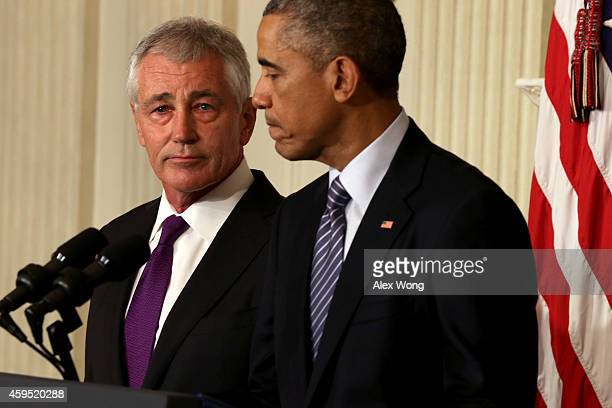 S President Barack Obama speaks as Secretary of Defense Chuck Hagel looks on during a press conference announcing Hagel's resignation in the State...