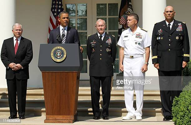 S President Barack Obama speaks as Secretary of Defense Robert Gates Army Chief of Staff Gen Martin Dempsey Navy Admiral James 'Sandy' Winnefeld and...