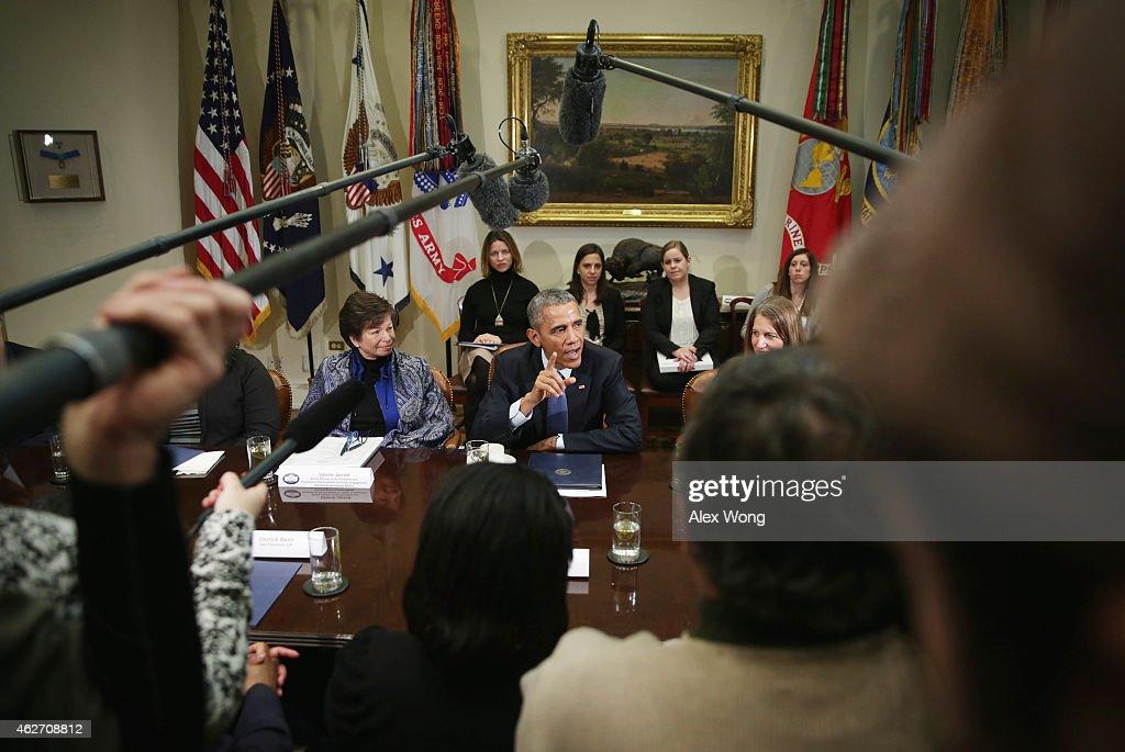 S President Barack Obama speaks as Secretary of Health and Human Services Sylvia Burwell and White House senior adviser Valerie Jarrett look on...
