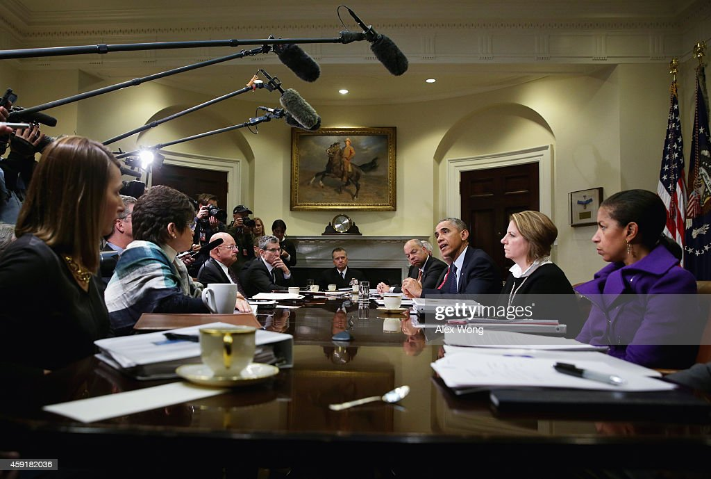 U.S. President Barack Obama (3rd R) speaks as Secretary of Homeland Security Jeh Johnson (4th R), White House Homeland Security Adviser Lisa Monaco (2nd R), National Security Adviser Susan Rice (R), and Director of National Intelligence James Clapper (7th R) listen during a meeting with his national security and public health teams November 18, 2014 at the Roosevelt Room of the White House in Washington, DC. President Obama received update on the Ebola response from his teams during the meeting.