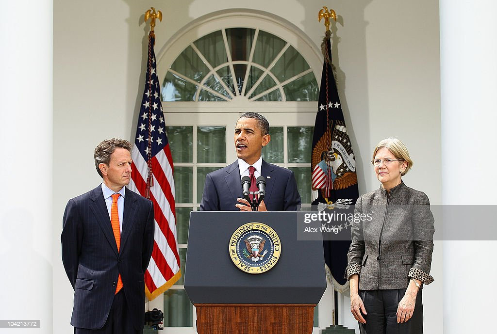 U.S. President <a gi-track='captionPersonalityLinkClicked' href=/galleries/search?phrase=Barack+Obama&family=editorial&specificpeople=203260 ng-click='$event.stopPropagation()'>Barack Obama</a> (C) speaks as Secretary of the Treasury <a gi-track='captionPersonalityLinkClicked' href=/galleries/search?phrase=Timothy+Geithner&family=editorial&specificpeople=5087853 ng-click='$event.stopPropagation()'>Timothy Geithner</a> (L) and Congressional Oversight Panel Chair <a gi-track='captionPersonalityLinkClicked' href=/galleries/search?phrase=Elizabeth+Warren&family=editorial&specificpeople=5396017 ng-click='$event.stopPropagation()'>Elizabeth Warren</a> (R) listen during a Rose Garden announcement September 17, 2010 at the White House in Washington, DC. Obama has appointed Warren to be his assistant and special adviser to the Secretary of the Treasury on the Consumer Financial Protection Bureau.