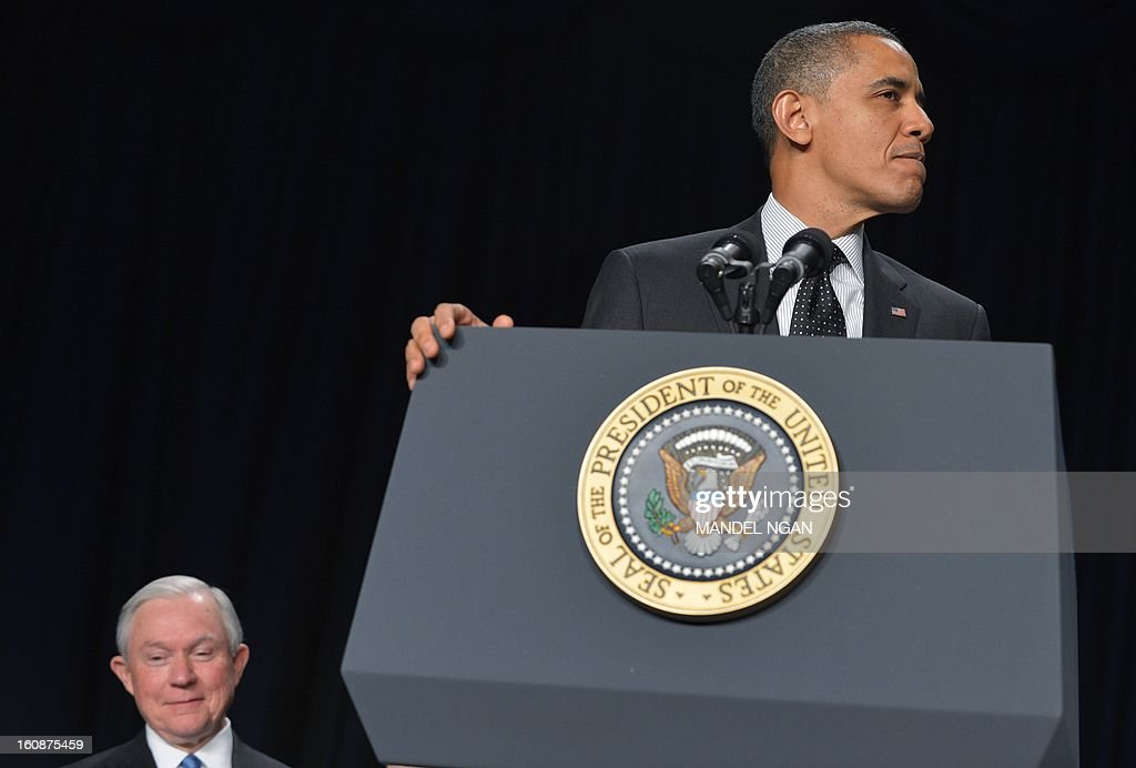 US President Barack Obama speaks as Senator Jeff Sessions (L), R-AL, looks on during the National Prayer Breakfast on February 7, 2013 in Washington, DC. After a morning of scripture and piety, President Obama on Thursday lamented that an annual National Prayer Breakfast had a 'shelf life' measured in minutes in poisoned US politics. Obama, headlining the annual multi-faith event, called on his fellow political leaders to show humility and to work together despite often fierce disagreements in the US capital's partisan swamp. AFP PHOTO/Mandel NGAN
