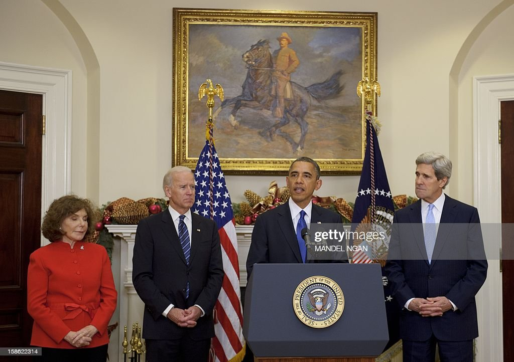 US President Barack Obama speaks as Senator John Kerry D-MA (R) watches while Obama announces his nomination of Kerry as the next secretary of state on December 21, 2012 in the Roosevelt Room of the White House in Washington, DC. At left is Kerry's wife Teresa Heinz Kerry, and Vice President Joe Biden. AFP PHOTO/Mandel NGAN