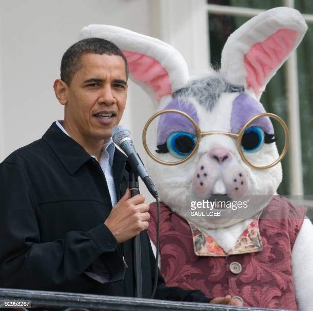 US President Barack Obama speaks as the Easter Bunny looks on during the annual White House Easter Egg Roll on the South Lawn of the White House in...