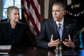 US President Barack Obama speaks as US Secretary of State Hillary Clinton listens at a cabinet meeting at the White House on November 28 2012 in...