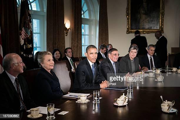 US President Barack Obama speaks as US Secretary of the Interior Ken Salazar US Secretary of State Hillary Clinton US Secretary of Defense Leon...