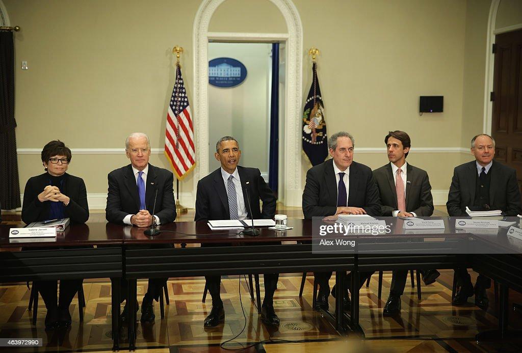 US President Barack Obama speaks as Vice President Joseph Biden White House senior adviser Valerie Jarrett and US Trade Representative Michael Froman...