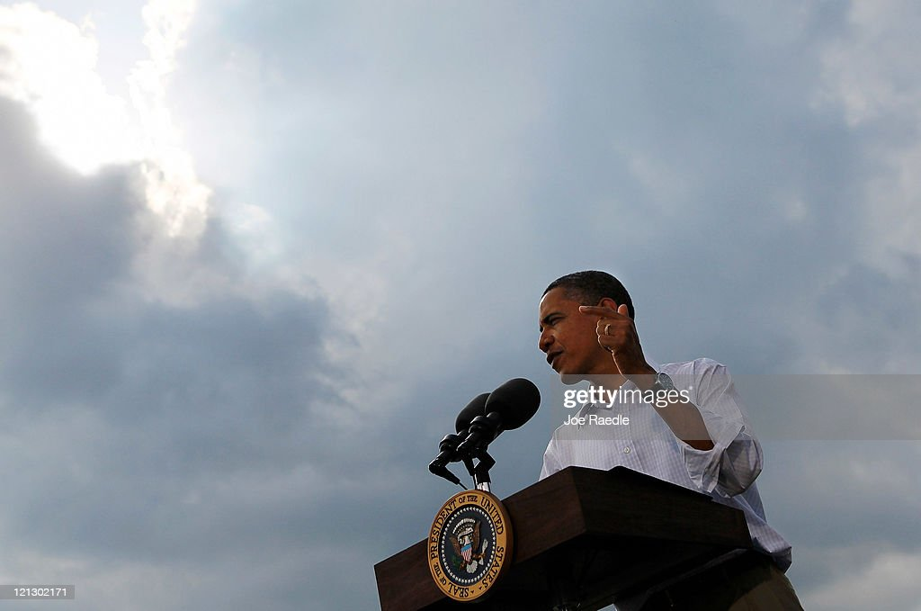 U.S. President Barack Obama speaks at a town hall style meeting at Country Corner Farm Market on August 17, 2011 in Alpha, Illinois. President Obama is on the last day of a three-day bus tour of Minnesota, Iowa and Illinois during which he will discuss ways to improve the economy and create jobs, and hear directly from Americans.
