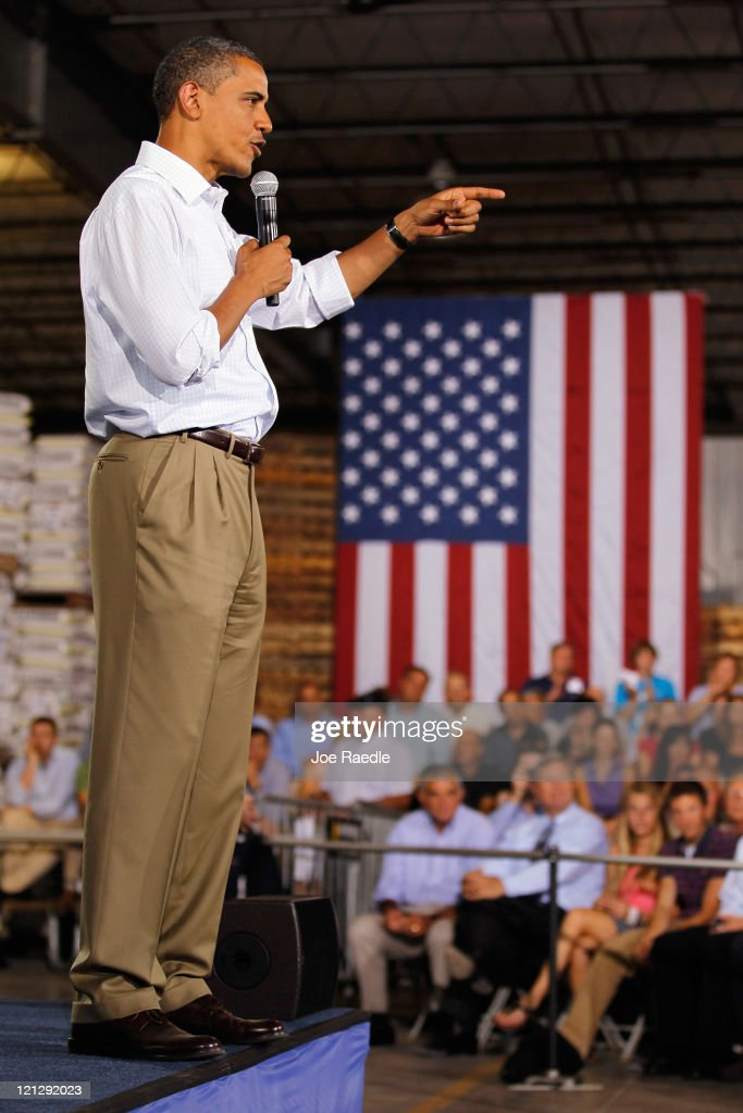 President Barack Obama speaks at a town hall-style meeting at Wyffels Hybrids Inc. on August 17, 2011 in Atkinson, Illinois. President Obama is on the last day of a three-day bus tour of Minnesota, Iowa and Illinois during which he will discuss ways to improve the economy and create jobs, and hear directly from Americans.