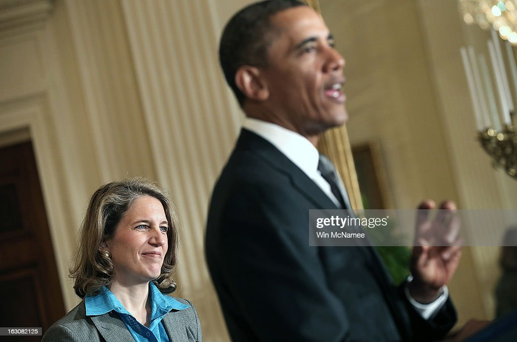 S. President Barack Obama (R) speaks at an event announcing the nominations of Sylvia Mathews Burwell (L), the President of the Walmart Foundation, as his budget chief, Gina McCarthy, to head the Environmental Protection Agency and MIT professor Ernest Moniz as Energy Secretary, during a ceremony in the East Room of the White House March 4, 2013 in Washington, DC. The nominations will be key appointments for Obama's second term while focusing on the issues of the national budget as well as energy and climate issues.