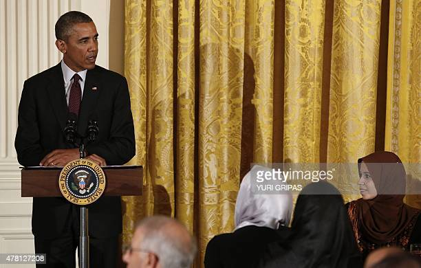 US President Barack Obama speaks at an Iftar dinner celebrating Ramadan in the State Dining Room at the White House in Washington DC on June 22 2015...
