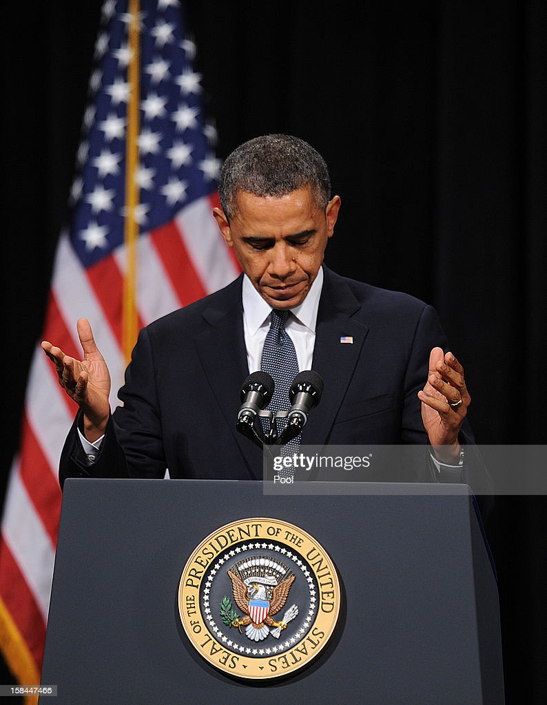 U.S. President <a gi-track='captionPersonalityLinkClicked' href=/galleries/search?phrase=Barack+Obama&family=editorial&specificpeople=203260 ng-click='$event.stopPropagation()'>Barack Obama</a> speaks at an interfaith vigil for the shooting victims from Sandy Hook Elementary School on December 16, 2012 at Newtown High School in Newtown, Connecticut. Twenty-six people were shot dead, including twenty children, after a gunman identified as Adam Lanza opened fire at Sandy Hook Elementary School. Lanza also reportedly had committed suicide at the scene. A 28th person, believed to be Nancy Lanza, found dead in a house in town, was also believed to have been shot by Adam Lanza.