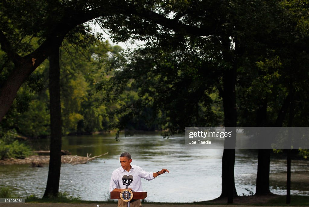 U.S. President Barack Obama speaks at the town hall style meeting at the Lower Hannah's Bend Park on August 15, 2011 in Cannon Falls, Minnesota. Obama is on a bus tour of Minnesota, Iowa and Illinois where he is scheduled to speak with people about economic issues at town hall style meetings.