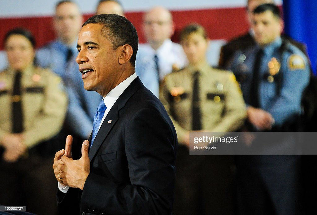 U.S. President Barack Obama speaks before a crowd of local leaders and law enforcement officials at the Minneapolis Police Department Special Operations Center on February 4, 2013 in Minneapolis, Minnesota. President Obama is promoting a ban on assault weapons and expanded background checks on gun buyers.