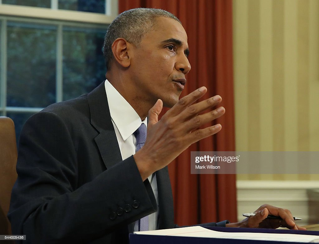 U.S. President Barack Obama speaks before signing a rescue package bill for Puerto Rico which is facing more than $70 billion in debt, in the Oval Office at the White House June 30, 2016 in Washington, DC.