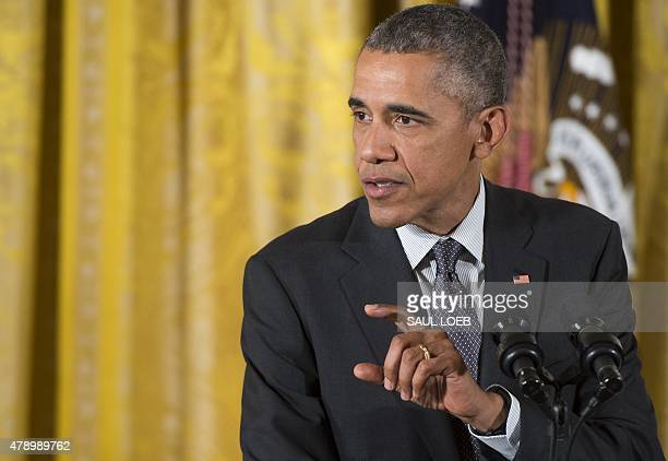 US President Barack Obama speaks before signing HR 1295 Trade Preferences Extension Act of 2015 which includes assistance for Americans who lost...