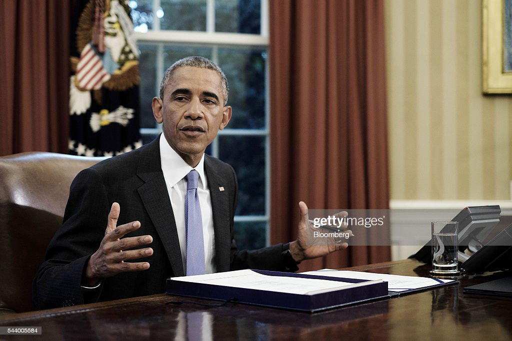 U.S. President <a gi-track='captionPersonalityLinkClicked' href=/galleries/search?phrase=Barack+Obama&family=editorial&specificpeople=203260 ng-click='$event.stopPropagation()'>Barack Obama</a> speaks before signing two bills, S. 2328: Puerto Rico Oversight, Management, and Economic Stability Act and S. 337: FOIA Improvement Act of 2016, in the Oval Office of the White House in Washington, D.C., U.S., on Thursday, June 30, 2016. Obama signed the bipartisan legislation that creates a financial control board to help restructure Puerto Ricos $70 billion in debt and oversee the islands finances, marking the largest federal intervention ever into the U.S. municipal bond market. Photographer: T.J. Kirkpatrick/Bloomberg via Getty Images