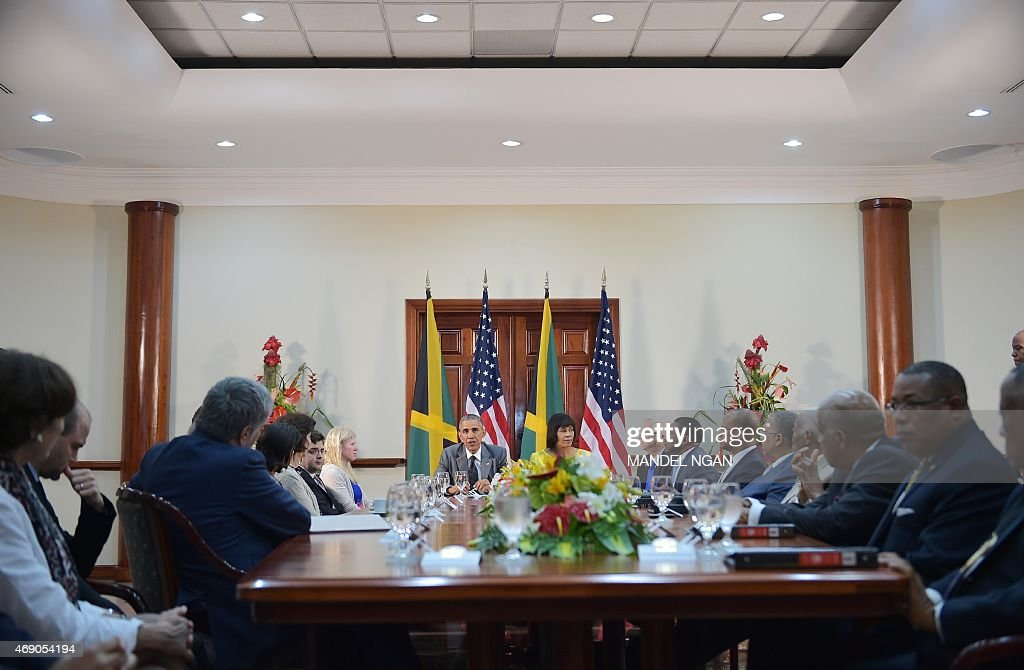 US President <a gi-track='captionPersonalityLinkClicked' href=/galleries/search?phrase=Barack+Obama&family=editorial&specificpeople=203260 ng-click='$event.stopPropagation()'>Barack Obama</a> speaks during a bilateral meeting with Jamaica's Prime Minister <a gi-track='captionPersonalityLinkClicked' href=/galleries/search?phrase=Portia+Simpson+Miller&family=editorial&specificpeople=4183773 ng-click='$event.stopPropagation()'>Portia Simpson Miller</a>(R back) at Jamaica House on April 9, 2015 in Kingston.