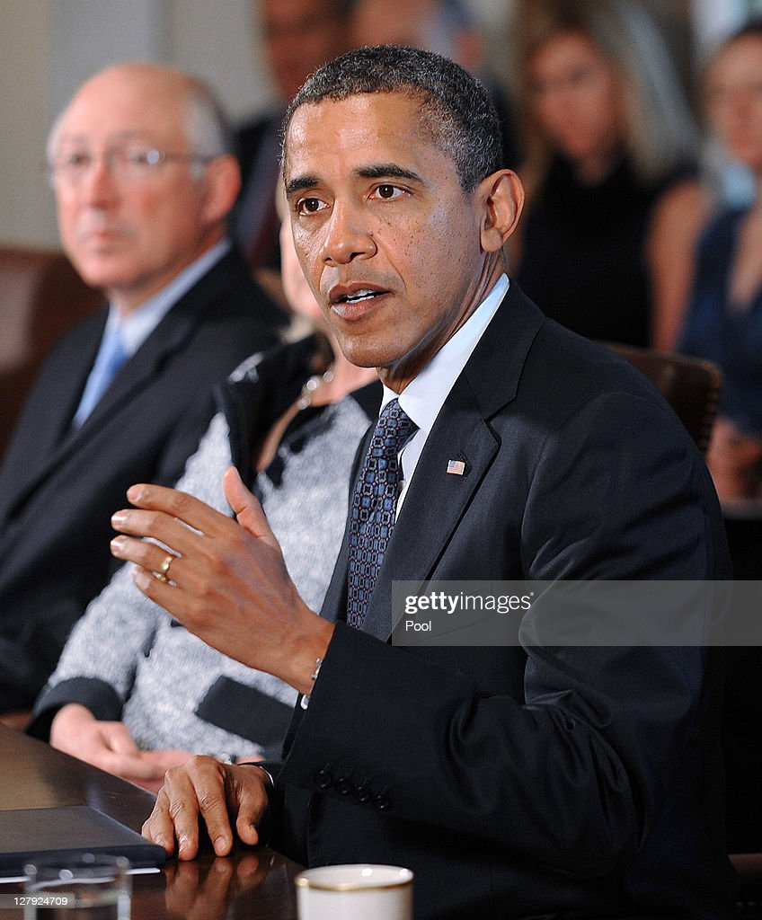 U.S. President <a gi-track='captionPersonalityLinkClicked' href=/galleries/search?phrase=Barack+Obama&family=editorial&specificpeople=203260 ng-click='$event.stopPropagation()'>Barack Obama</a> (R) speaks during a Cabinet Meeting as U.S. Secretary of Interior Kenneth Salazar listens in the Cabinet Room October 3, 2011 at the White House in Washington, DC. Obama urged Congress to pass a jobs bill during his statement.