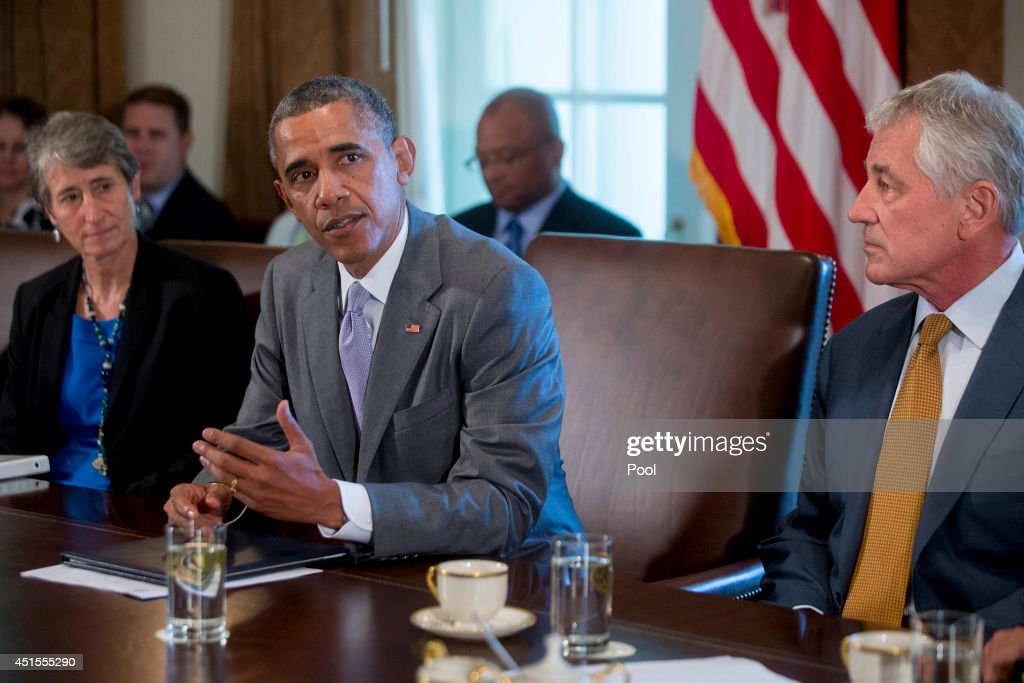 US President Barack Obama speaks during a cabinet meeting at the White House with Sally Jewell US secretary of the interior secretary left and US...