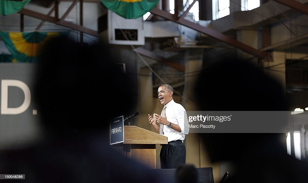 U.S. President <a gi-track='captionPersonalityLinkClicked' href=/galleries/search?phrase=Barack+Obama&family=editorial&specificpeople=203260 ng-click='$event.stopPropagation()'>Barack Obama</a> speaks during a campaign stop at the Palace of Agriculture on the Colorado State Fairgrounds August 9, 2012 in Pueblo, Colorado. Obama covered a number of topics including paying down our debt in a balanced way, job growth and creation and preventing a scheduled tax increase.