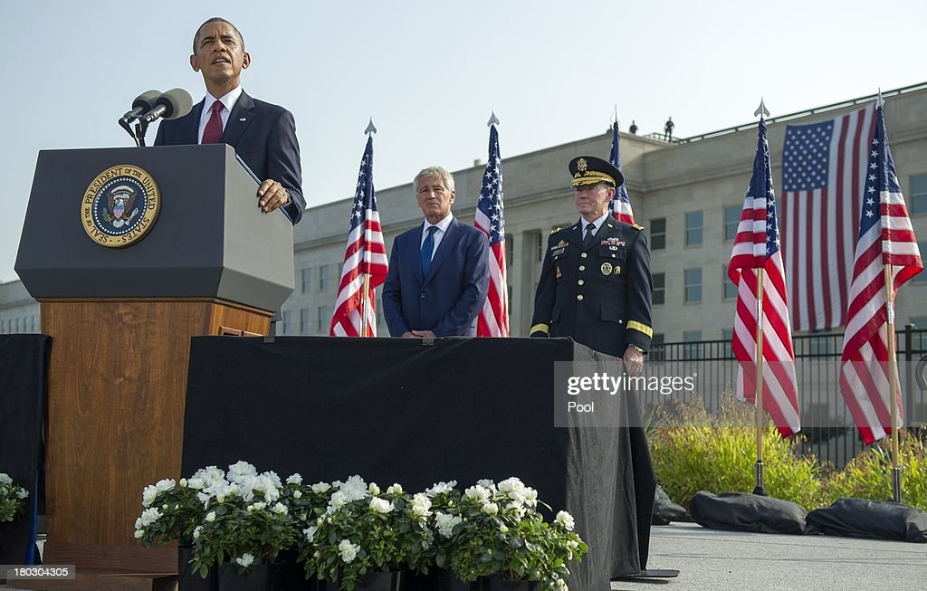 U.S. President <a gi-track='captionPersonalityLinkClicked' href=/galleries/search?phrase=Barack+Obama&family=editorial&specificpeople=203260 ng-click='$event.stopPropagation()'>Barack Obama</a> speaks during a ceremony in observance of the terrorist attacks of 9/11 as Defense Secretary <a gi-track='captionPersonalityLinkClicked' href=/galleries/search?phrase=Chuck+Hagel&family=editorial&specificpeople=504963 ng-click='$event.stopPropagation()'>Chuck Hagel</a> and Chairman of the Joint Chiefs of Staff Gen. <a gi-track='captionPersonalityLinkClicked' href=/galleries/search?phrase=Martin+Dempsey&family=editorial&specificpeople=2116621 ng-click='$event.stopPropagation()'>Martin Dempsey</a> listen at the Pentagon September 11, 2013 in Arlington, Virginia. Family members of the Pentagon attack victims and survivors of the attack gathered to hear from Obama and other leaders at the National 9/11 Pentagon Memorial near the place where terrorists drove a jetliner into the Department of Defense headquarters in 2001.