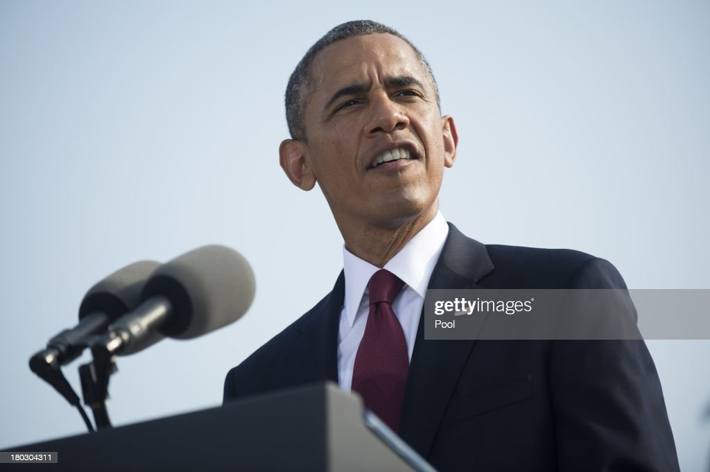 S. President <a gi-track='captionPersonalityLinkClicked' href=/galleries/search?phrase=Barack+Obama&family=editorial&specificpeople=203260 ng-click='$event.stopPropagation()'>Barack Obama</a> speaks during a ceremony in observance of the terrorist attacks of 9/11 as Defense Secretary Chuck Hagel (L) and Chairman of the Joint Chiefs of Staff Gen. Martin Dempsey listen at the Pentagon September 11, 2013 in Arlington, Virginia. Family members of the Pentagon attack victims and survivors of the attack gathered to hear from Obama and other leaders at the National 9/11 Pentagon Memorial near the place where terrorists drove a jetliner into the Department of Defense headquarters in 2001.