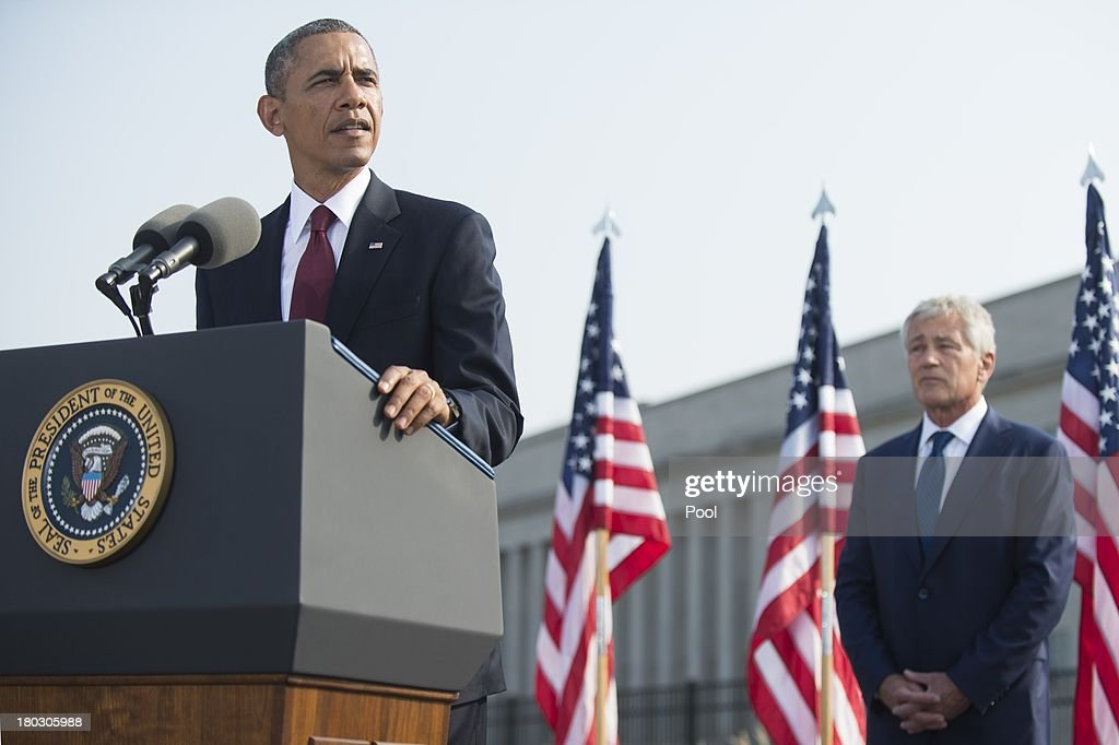 U.S. President <a gi-track='captionPersonalityLinkClicked' href=/galleries/search?phrase=Barack+Obama&family=editorial&specificpeople=203260 ng-click='$event.stopPropagation()'>Barack Obama</a> speaks during a ceremony in observance of the terrorist attacks of 9/11 as Defense Secretary <a gi-track='captionPersonalityLinkClicked' href=/galleries/search?phrase=Chuck+Hagel&family=editorial&specificpeople=504963 ng-click='$event.stopPropagation()'>Chuck Hagel</a> listens at the Pentagon September 11, 2013 in Arlington, Virginia. Family members of the Pentagon attack victims and survivors of the attack gathered to hear from Obama and other leaders at the National 9/11 Pentagon Memorial near the place where terrorists drove a jetliner into the Department of Defense headquarters in 2001.