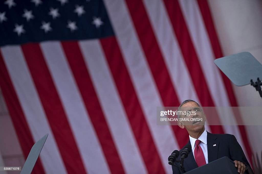 US President Barack Obama speaks during a event to honor Memorial Day at Arlington National Cemetery on May 30, 2016 in Arlington, Virginia. / AFP / Brendan Smialowski