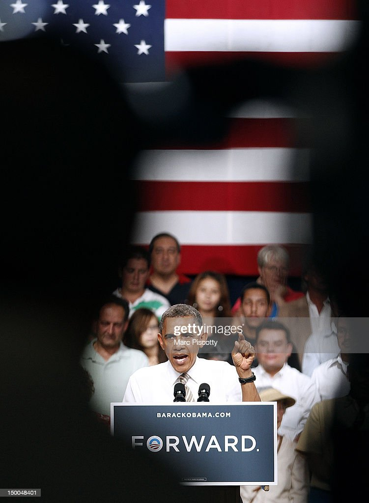 U.S. President <a gi-track='captionPersonalityLinkClicked' href=/galleries/search?phrase=Barack+Obama&family=editorial&specificpeople=203260 ng-click='$event.stopPropagation()'>Barack Obama</a> speaks during a grassroots campaign stop at the Palace of Agriculture on the Colorado State Fairgrounds August 9, 2012 in Pueblo, Colorado. Obama covered a number of topics including paying down our debt in a balanced way, job growth and creation and preventing a scheduled tax increase on 98 percent of Americans.