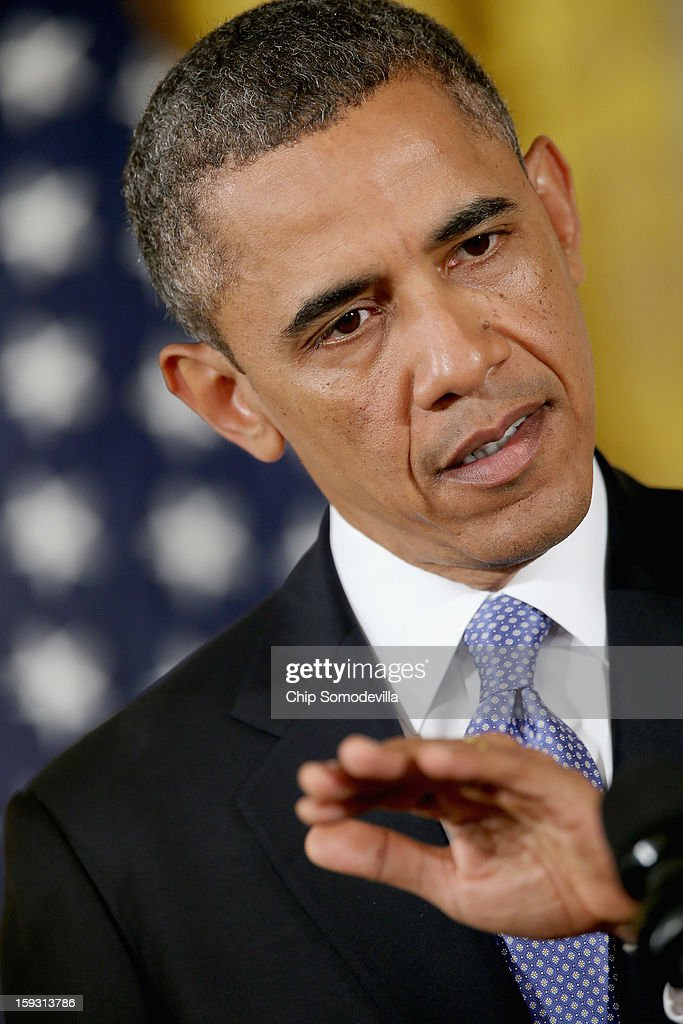 U.S. President <a gi-track='captionPersonalityLinkClicked' href=/galleries/search?phrase=Barack+Obama&family=editorial&specificpeople=203260 ng-click='$event.stopPropagation()'>Barack Obama</a> speaks during a joint news conference with Afghan President Hamid Karzai in the East Room of the White House January 11, 2013 in Washington, DC. Karzai is in Washington for face-to-face meetings with Obama and senior members of his administration about the future of American commitment to Afghanistan and when troops may leave the country after more than 10 years of war.