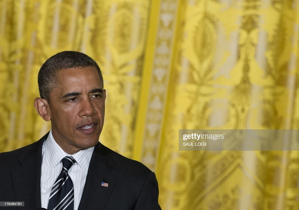 US President <a gi-track='captionPersonalityLinkClicked' href=/galleries/search?phrase=Barack+Obama&family=editorial&specificpeople=203260 ng-click='$event.stopPropagation()'>Barack Obama</a> speaks during a LGBT Pride Month celebration in the East Room of the White House in Washington, DC, June 13, 2013. AFP PHOTO / Saul LOEB