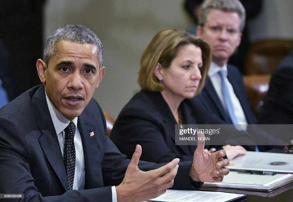 US President Barack Obama speaks during a meeting with members of his national security team on cybersecurity on February 9, 2016 in the Roosevelt Room of the White House in Washington, DC. President Barack Obama on February 9 unveiled a new cybersecurity 'national action plan' calling for an overhaul of aging government networks and a high-level commission to boost security awareness. The announcement responds to an epidemic of data breaches and cyber attacks on both government and private networks in recent years, and passage last year of a cybersecurity bill that aims to facilitate better threat sharing. Looking on at center is Lisa Monaco, United States Homeland Security Advisor to President Barack Obama, and Office of Management and Budget Director Shaun Donovan. / AFP / Mandel Ngan
