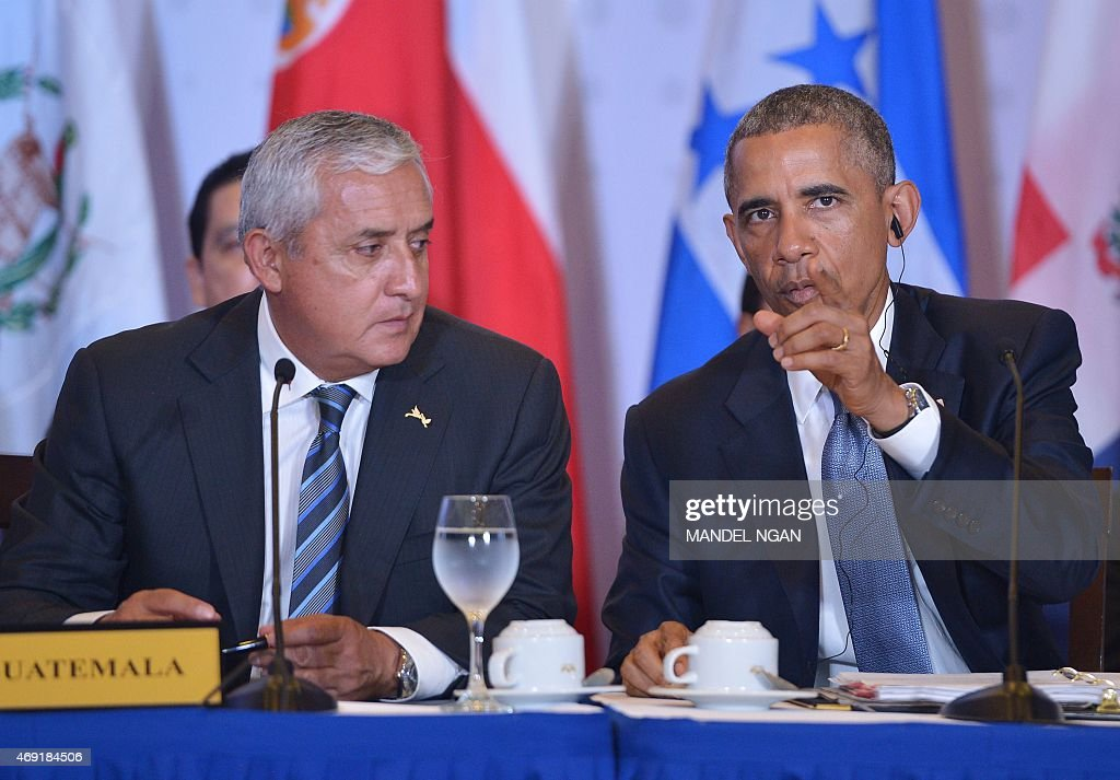 US President Barack Obama speaks during a meeting with members of the Central American Integration System beside Guatemala's President Otto Perez...