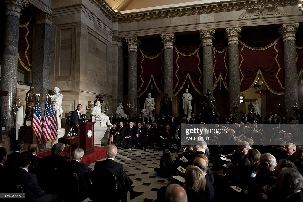 US President <a gi-track='captionPersonalityLinkClicked' href=/galleries/search?phrase=Barack+Obama&family=editorial&specificpeople=203260 ng-click='$event.stopPropagation()'>Barack Obama</a> speaks during a memorial service for former Speaker of the House Tom Foley in Statuary Hall at the US Capitol in Washington, DC, October 29, 2013. Foley, who served as Speaker from June 1989 to January 1995, died October 18 from a stroke. AFP PHOTO / Saul LOEB
