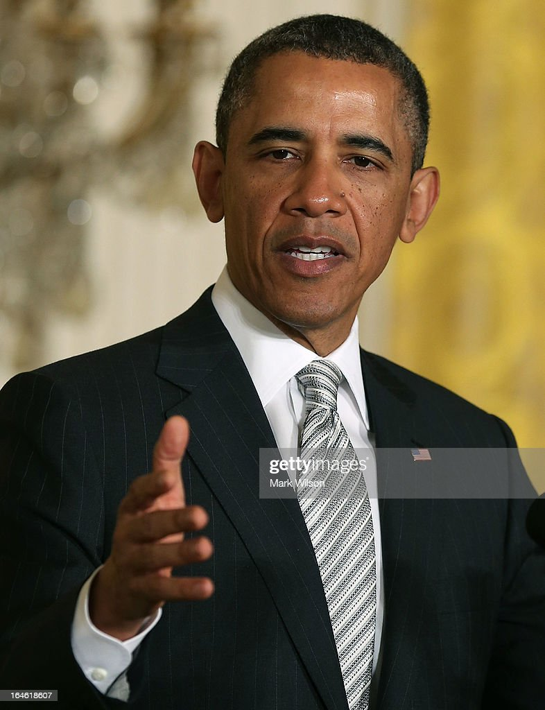 U.S. President <a gi-track='captionPersonalityLinkClicked' href=/galleries/search?phrase=Barack+Obama&family=editorial&specificpeople=203260 ng-click='$event.stopPropagation()'>Barack Obama</a> speaks during a naturalization ceremony in the East Room of the White House on March 25, 2013 in Washington DC. Homeland Security Secretary Janet Napolitano administered the oath of allegiance to active duty service members and civilians officially granting them United States citizenship.