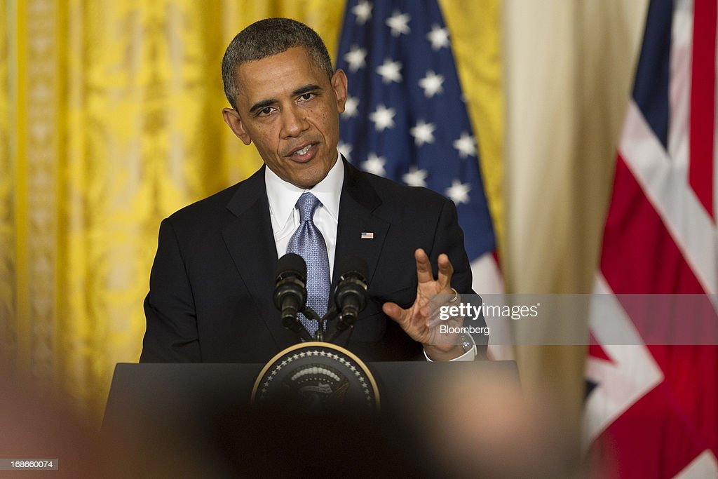 U.S. President <a gi-track='captionPersonalityLinkClicked' href=/galleries/search?phrase=Barack+Obama&family=editorial&specificpeople=203260 ng-click='$event.stopPropagation()'>Barack Obama</a> speaks during a news conference with David Cameron, U.K. prime minister, not pictured, in the East Room of the White House in Washington, D.C., U.S., on Monday, May 13, 2013. President <a gi-track='captionPersonalityLinkClicked' href=/galleries/search?phrase=Barack+Obama&family=editorial&specificpeople=203260 ng-click='$event.stopPropagation()'>Barack Obama</a> said his administration made no attempt to cover up or downplay the involvement of terrorists in last year's deadly attack on a U.S. outpost in Benghazi, Libya, and said the congressional investigation has turned into a 'political circus.' Photographer: Andrew Harrer/Bloomberg via Getty Images